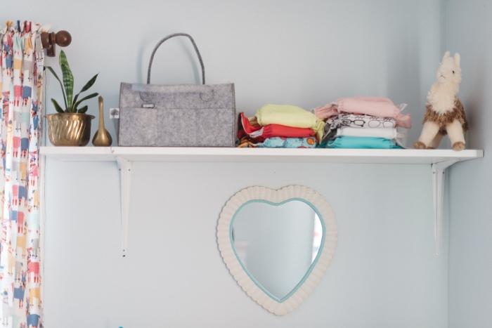 bumgenius cloth diapers on shelf in Penelope's nursery
